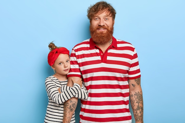 Lovely stylish ginger daughter and father posing together