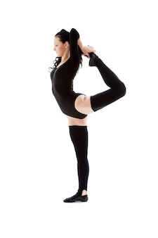 Lovely woman in black leotard working out over white