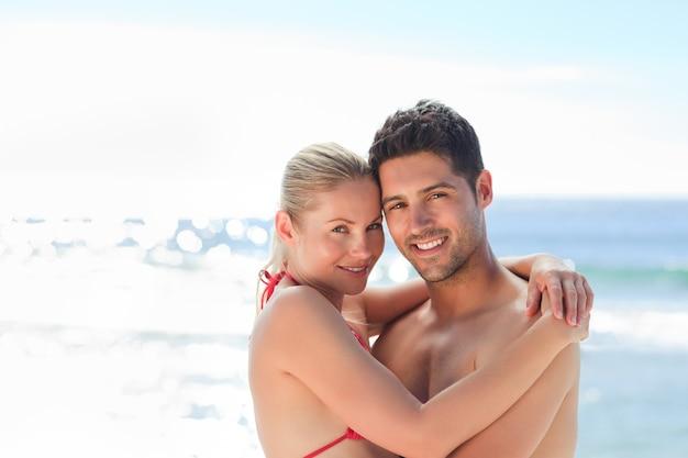 Lovely woman in her boyfriend's arms