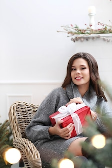 Lovely woman at home at christmas