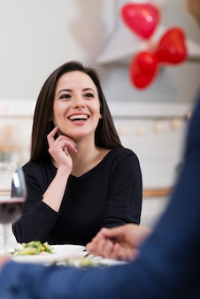 Lovely woman looking at her husband