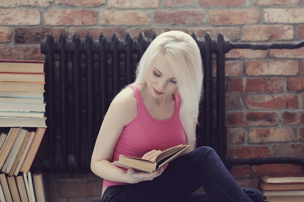 Lovely woman reading a book