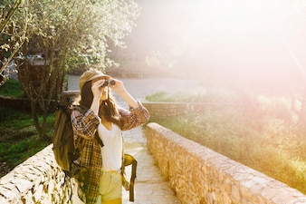 Lovely woman using binoculars