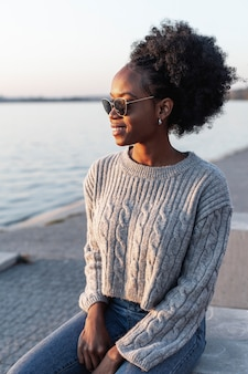 Lovely woman wearing sunglasses and looking away