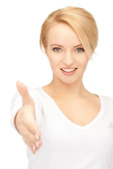 握手の準備ができて開いた手を持つ素敵な女性