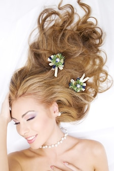 Lovely woman with christmas decorations in hair
