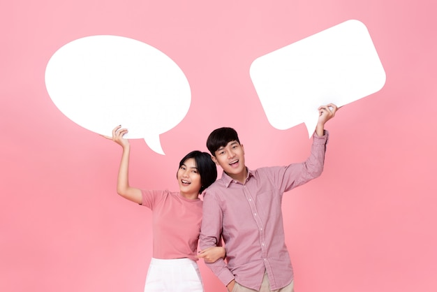 Lovely young asian couple with speech bubbles