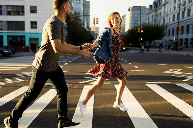 Lovely young couple dressed in casual style walks around soho and new york city in morning lights