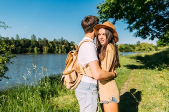 Lovely young couple embracing at outdoors