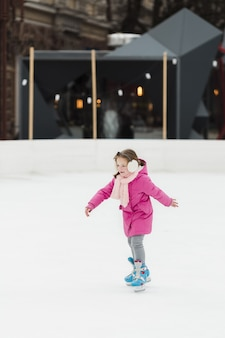 Lovely young girl ice skating