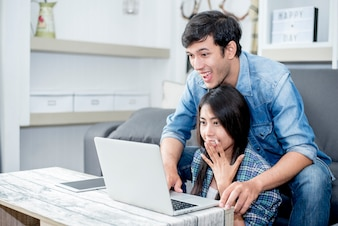 Lover are surprising when using the laptop. Family concept, Lovers concept, Technology concept