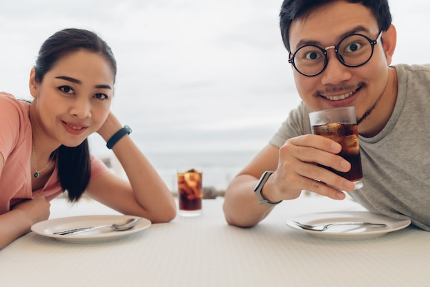 Lover couple having a date at the restaurant on the beach.