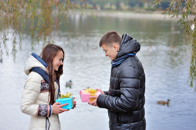 Lovers give each other a gift. valentine dating