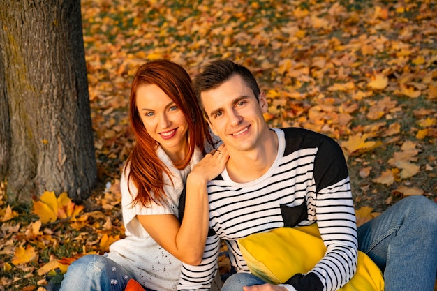 Lovers man and woman in the park in autumn