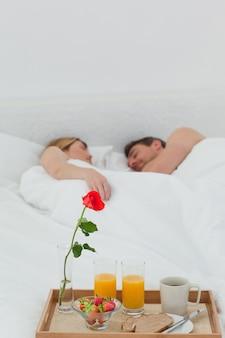 Lovers sleeping after having breakfast