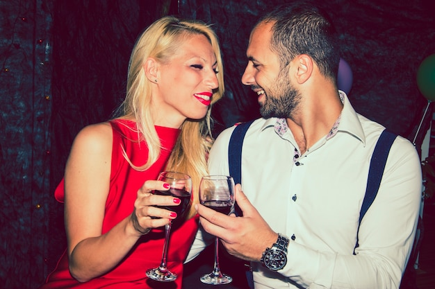 Lovers with wine at the party