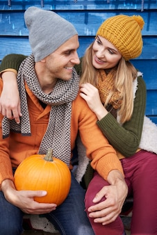 Loving couple after the picking pumpkins
