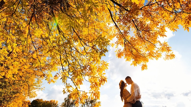 Loving couple in a beautiful autumn forest