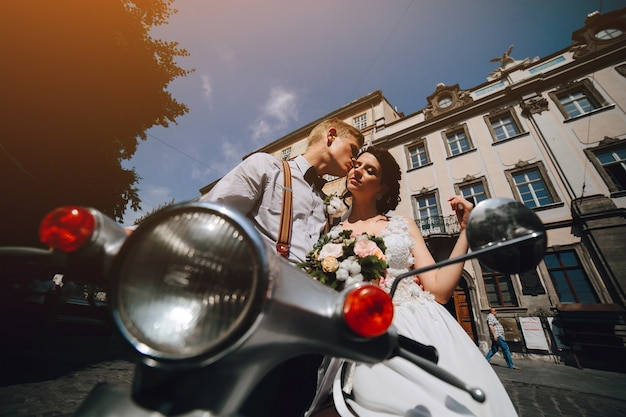 Loving couple on the bike