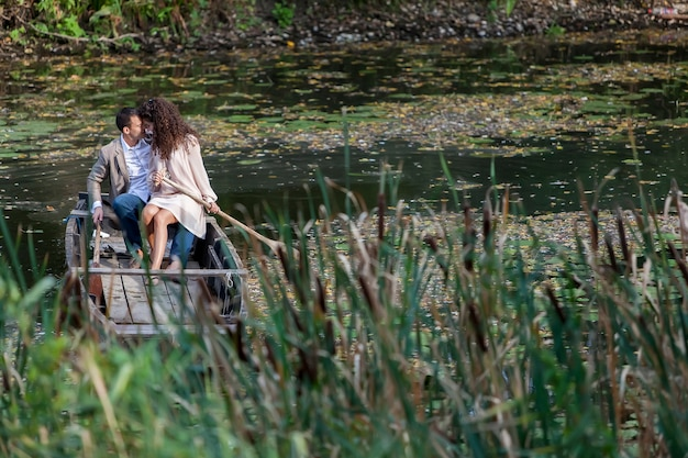 Loving couple in the boat