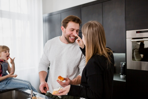 Loving couple cooking and having fun