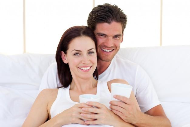 Loving couple drinking coffee