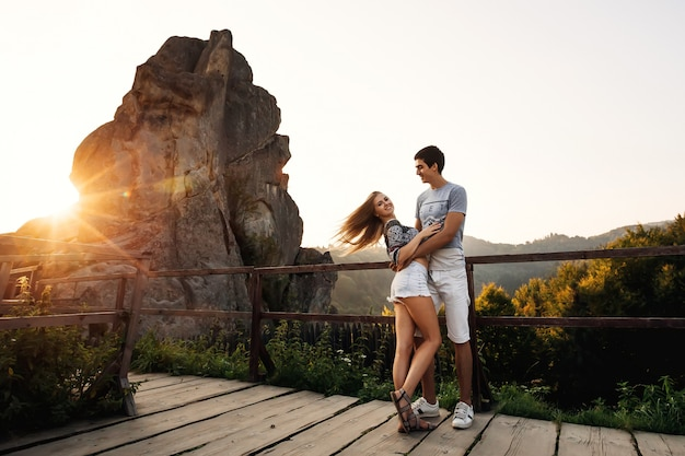 Loving couple hugging on the observation deck
