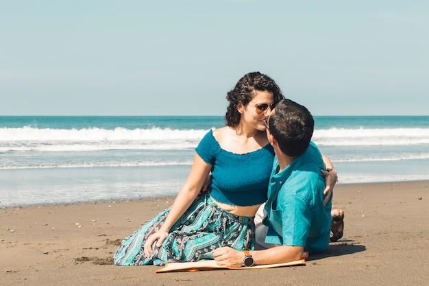 Loving couple kissing by seashore