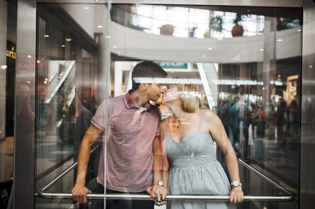 Loving couple kissing in an elevator