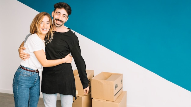 Loving couple moving to new flat