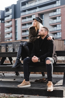 Loving couple relaxing outdoor. cute couple of hipsters is walking in spring park. beautiful sunny day. walking on the city's street, spring evening. home purchase concept.