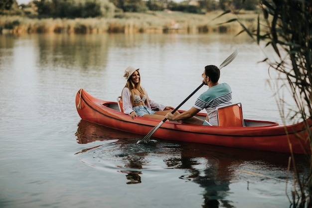Loving couple rowing on the lake