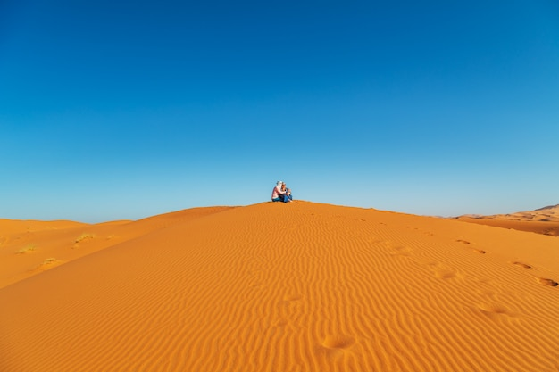 Loving couple in the sahara desert.