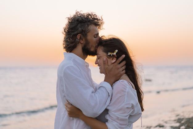 Loving couple on the seashore. happy together. happy valentines day. Premium Photo