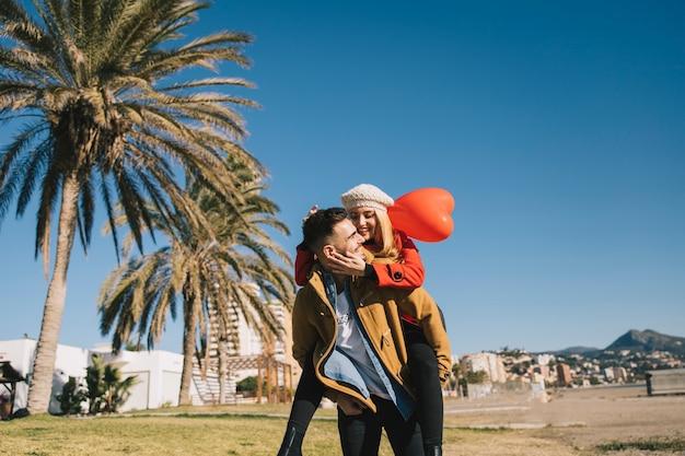 Loving couple on shoreline in sunlight