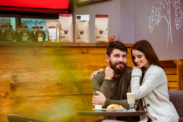 Loving couple sitting in a coffee shop.