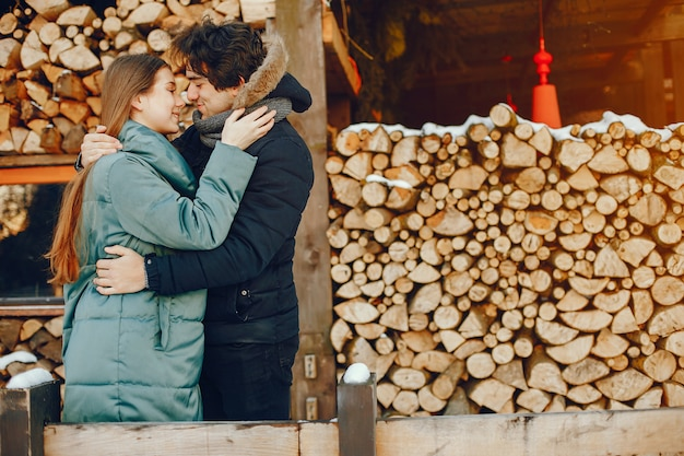 Loving couple standing in a winter park