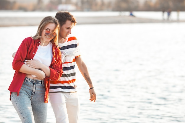 Loving couple on the sunset beach. woman and man together
