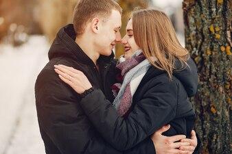 Loving couple wallking in a snowy park