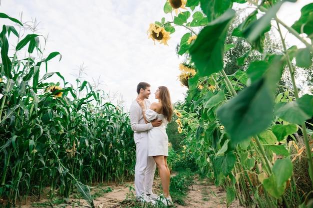 Loving couple in white dresses kissing