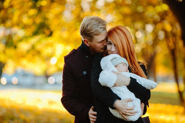 Loving couple with infant child