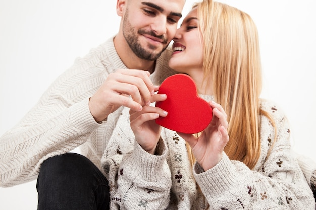 Loving couple with red heart