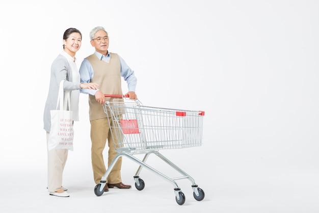 Loving elderly couples shopping