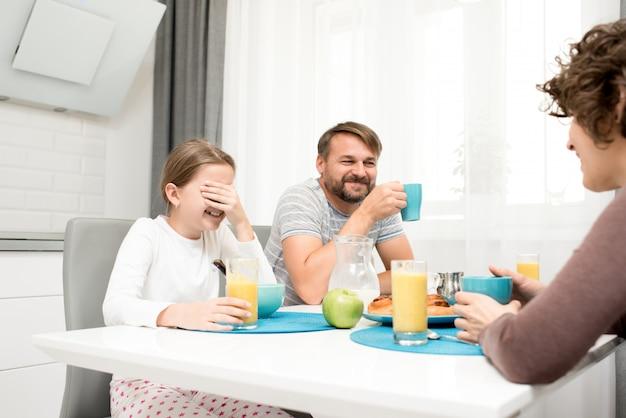 Loving family at breakfast