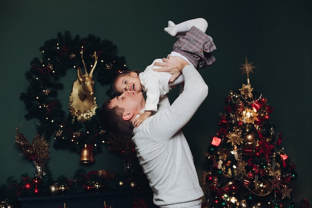 Loving father playing with his daughter at christmas.