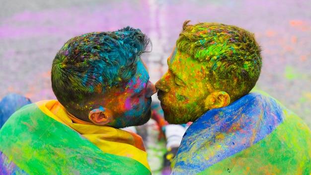 Loving gay couple gathered kissing