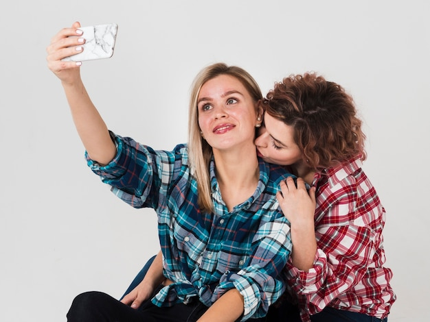 Loving gay couple taking selfie for valentines