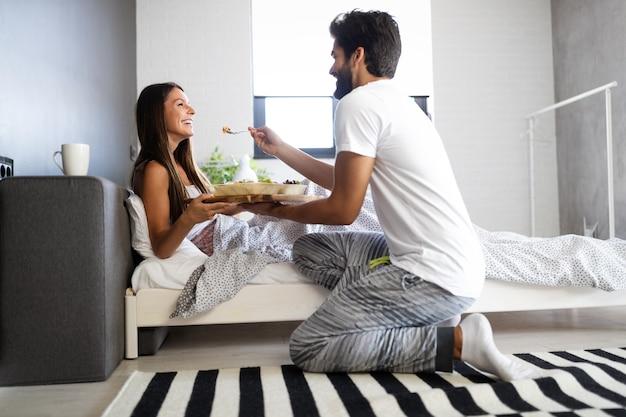 Loving happy couple having breakfast in bed. loving couple. family relationships.
