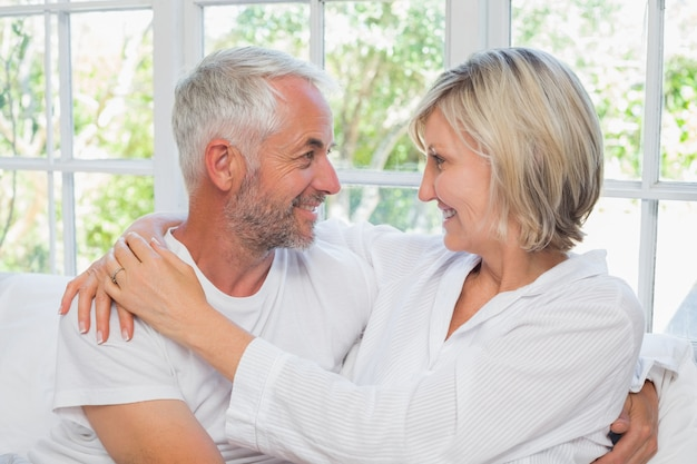 Loving happy mature couple with arm around