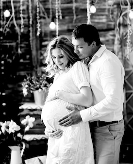 Loving husband gently hugging his pregnant wife. happy family in anticipation of the birth of the baby.